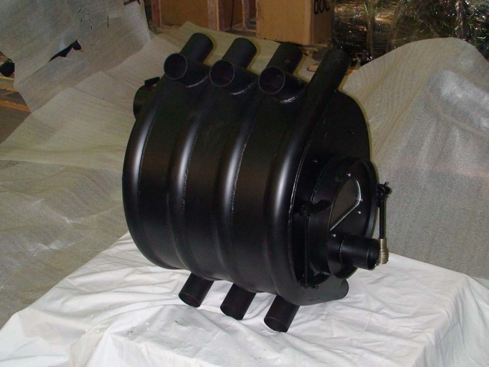 Заводская печка для отопления поможет создать комфортную атмосферу в гараже