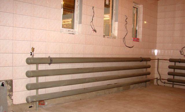 Отопительные батареи для водной системы отопления считаются идеальным вариантом обогрева гаража